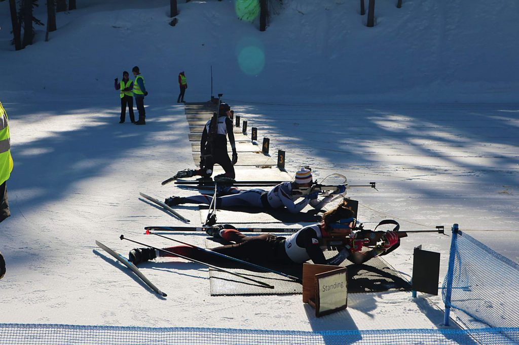 Steffen Cuneo (bottom) aims his rifle down range during the 10th Mountain Division Biathlon on Sunday. Cuneo took first place in the men's pro division.
