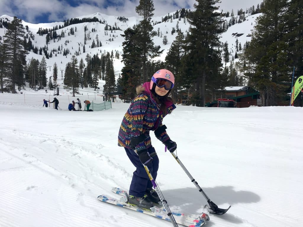 Charlotte Sandford, 12, poses for a picture after skiing down a slope at Alpine Meadows in April 2019. For the past three season, Sandford, who has cerebral palsy, has been skiing through Achieve Tahoe, a North Tahoe-based nonprofit that provides adaptive sports and recreation for people with disabilities.