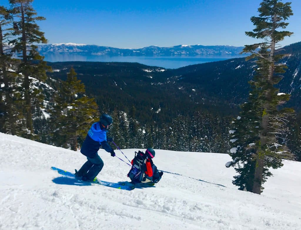 Jennifer Weast, of who was injured while skiing at age 16, skis down the mountain at Alpine Meadows with Achieve Tahoe's Michael Hunter.
