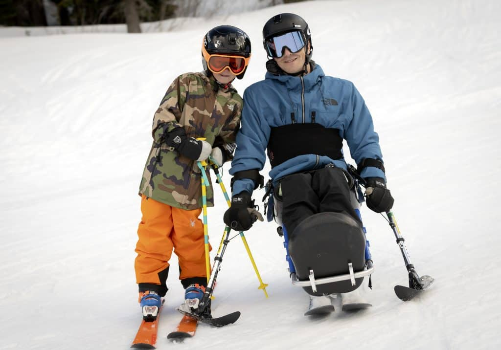North Lake Tahoe native Jason Abraham, right, poses with his son, Ebbett, while skiing at Alpine Meadows. Abraham was injured while skiing at Squaw Valley in 2015.