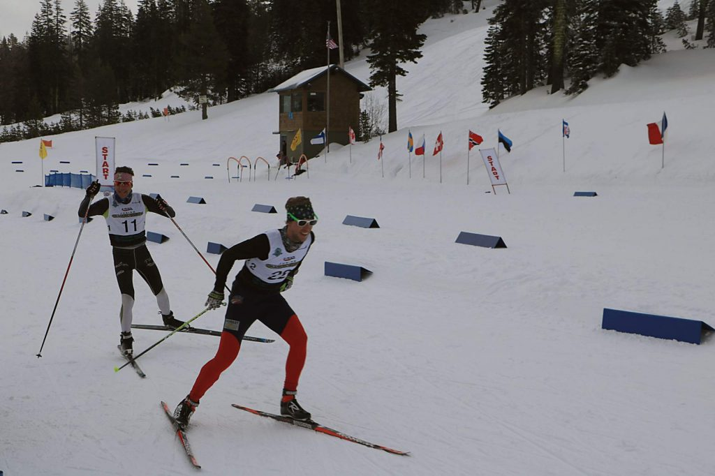 Local athlete Patrick Johnson (22) skis to a first-place finish at Auburn Ski Club on Sunday as Wyatt Fereday pursues.