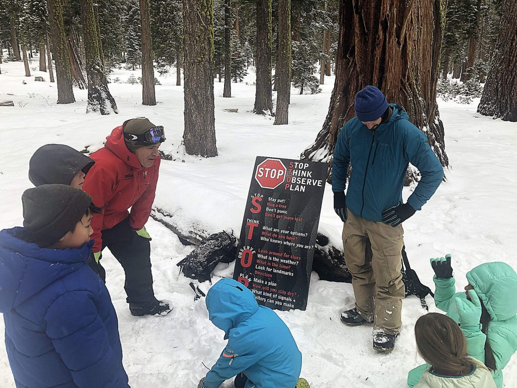 The Tahoe Nordic Search and Rescue team conducting Winter Wilderness Survival Program for 4th Graders at Tahoe Lake Elementary School.