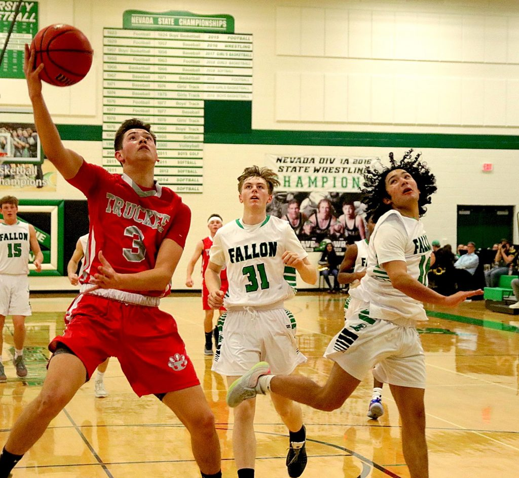Isaac Cruz (3) of Truckee takes Fallon's Toby Anderson (10) and Anthony Geer to the basket.