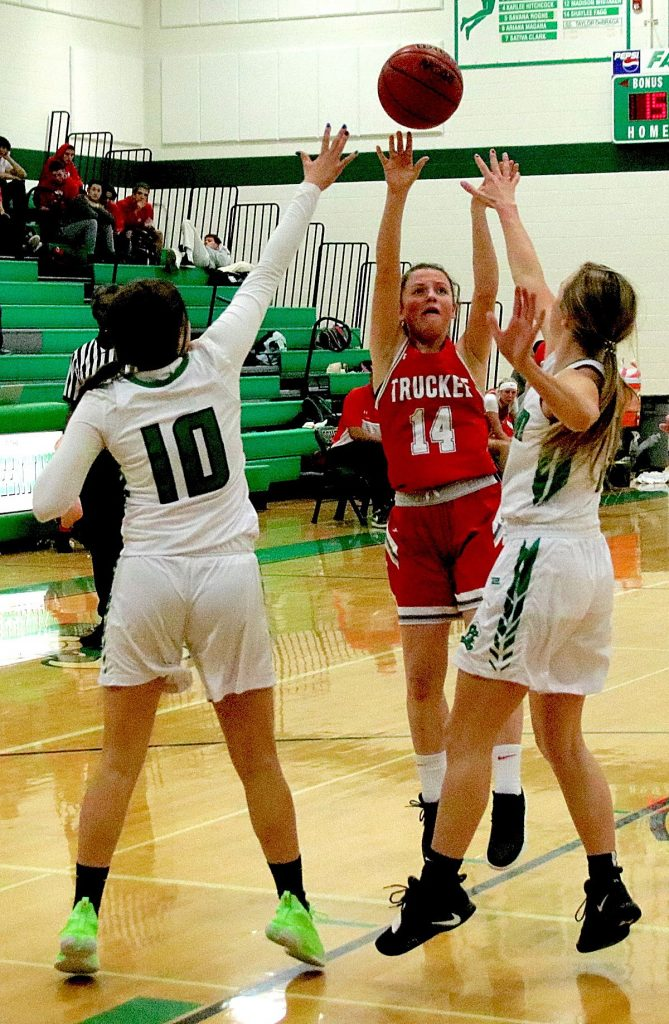 Tessa Brown (14) of Truckee takes a jump shot against the Greenwave.