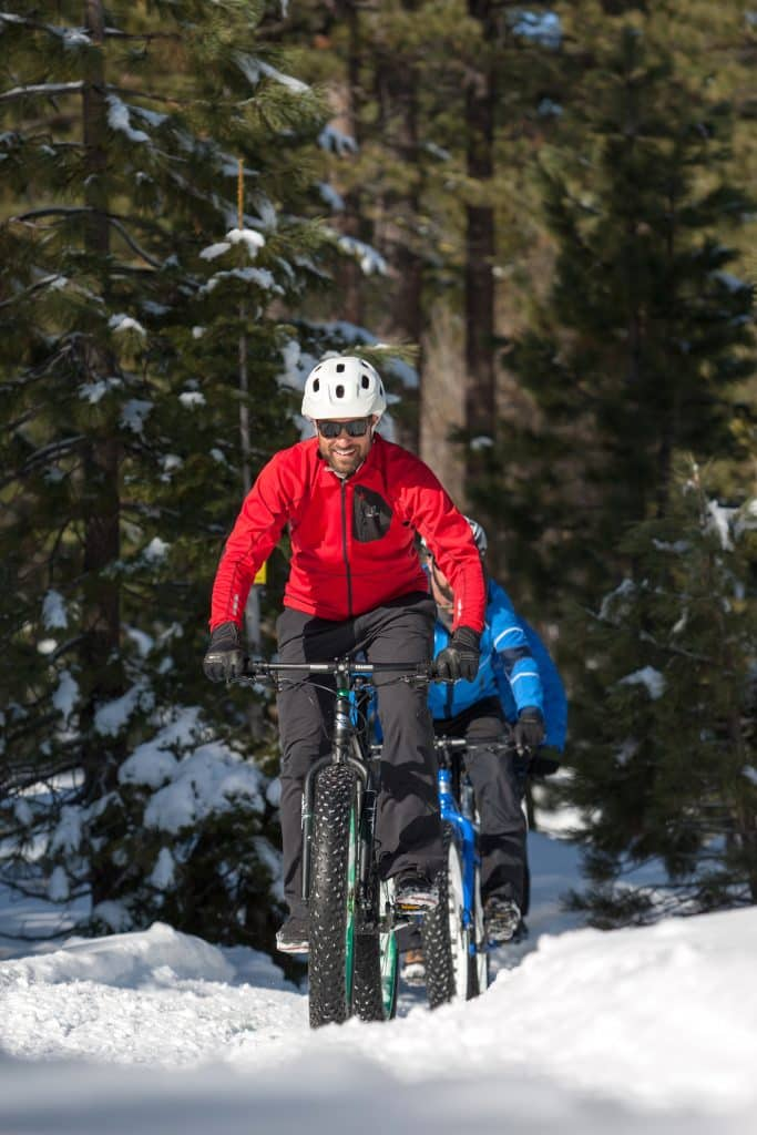 Recreationists ride fat bikes on the groomed cross-country ski trails at Tahoe Donner.
