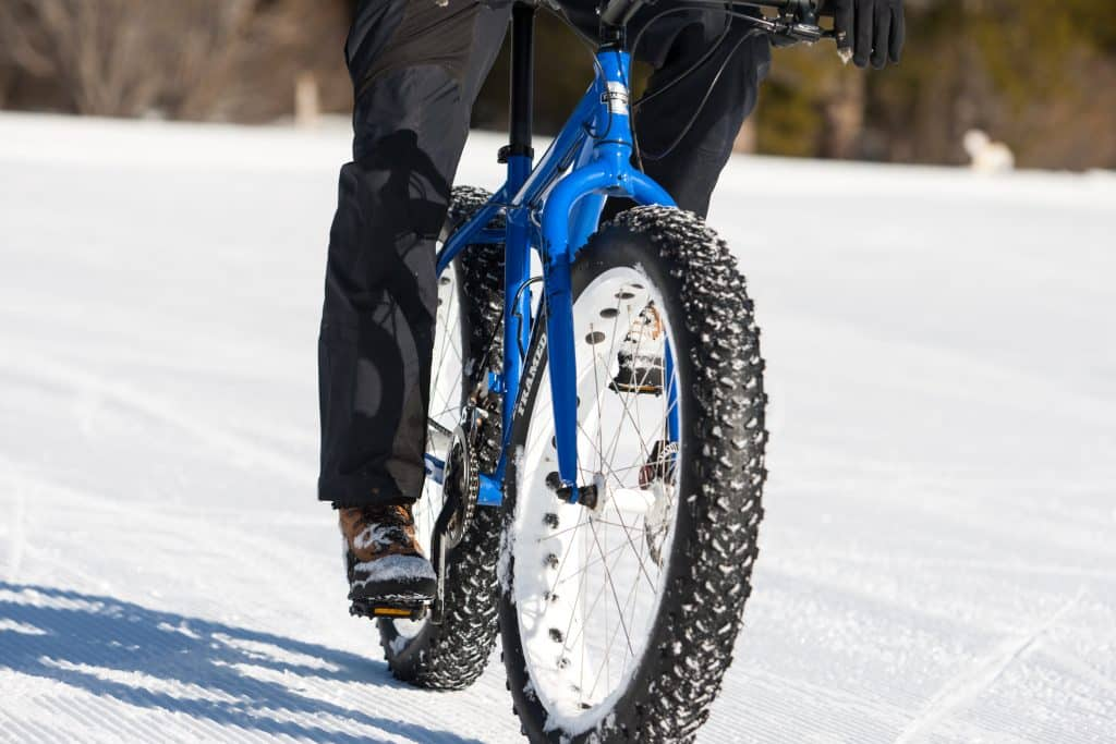 Fat bikes are bikes with over-sized tires at least 4 inches wide that are designed for low ground pressure to allow for riding on soft unstable terrain, like snow.