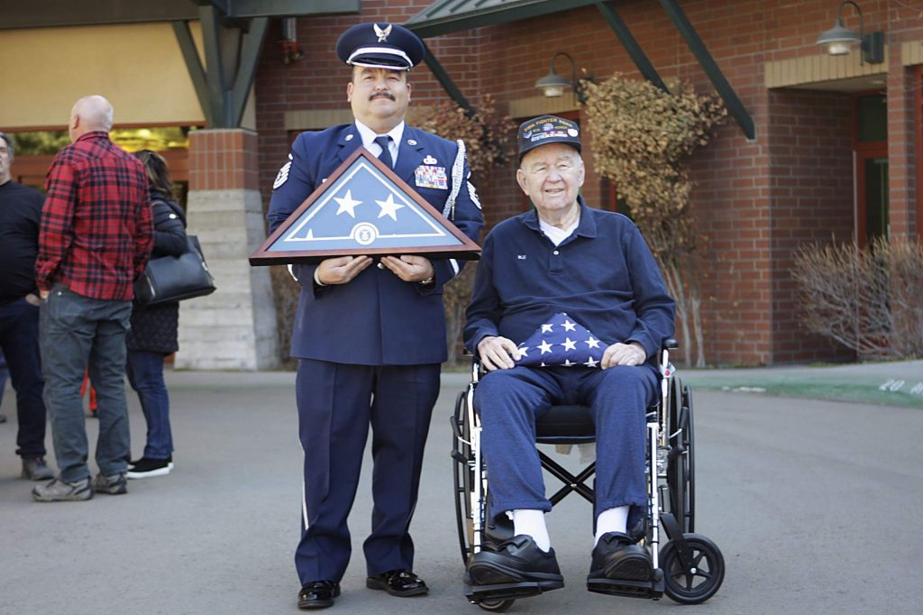 Master Sgt. Roberto Fabela, left, and William J. Brown pose following a ceremony honoring Brown on his 89th birthday.