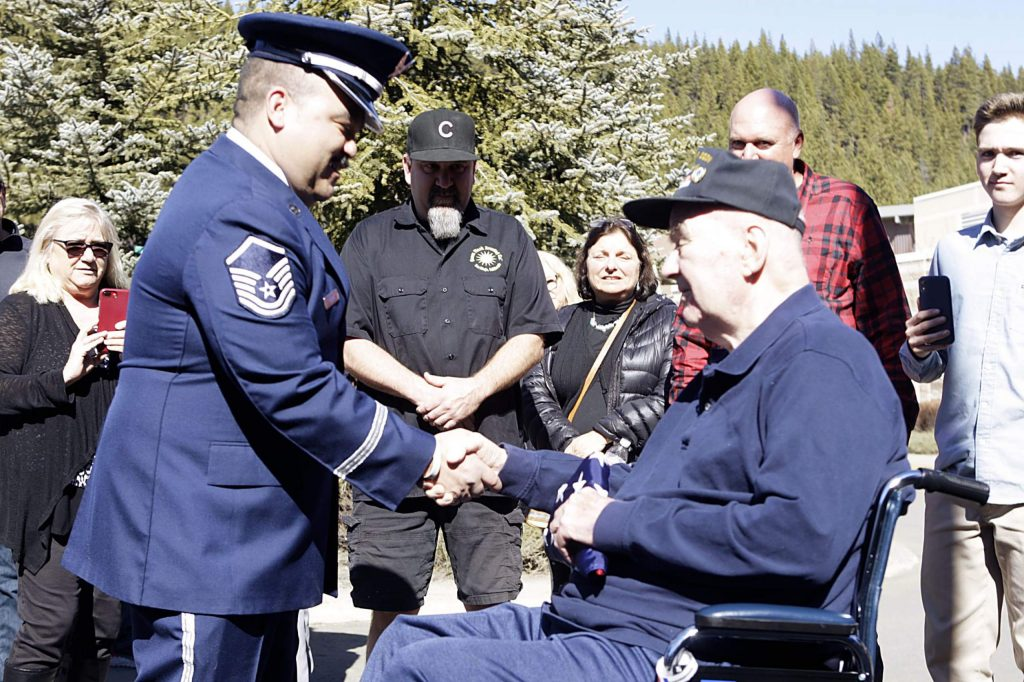 Korean War veteran William Brown and Master Sgt. Roberto Fabela come together during a ceremony honoring Brown on Saturday, Feb. 22.