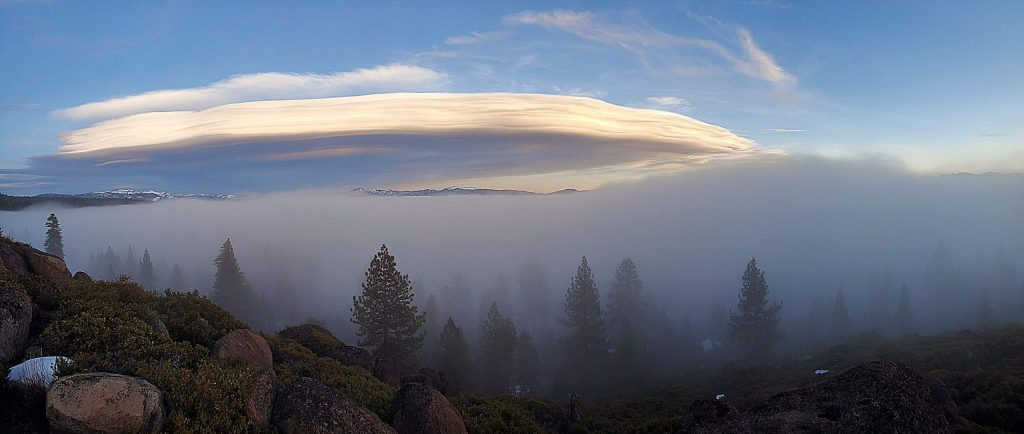 Lenticular cloud over a foggy Lake Tahoe.