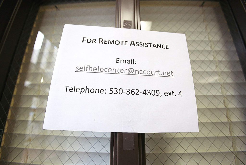 Remote assistance signs can be seen placed throughout the Nevada County Courthouse.