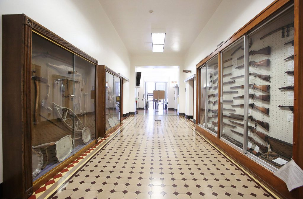 The historical displays of early weapons and mining equipment sit in display cases along the ground floor of the Nevada County Courthouse, which has almost all but stopped regular services due to COVID-19 concerns.