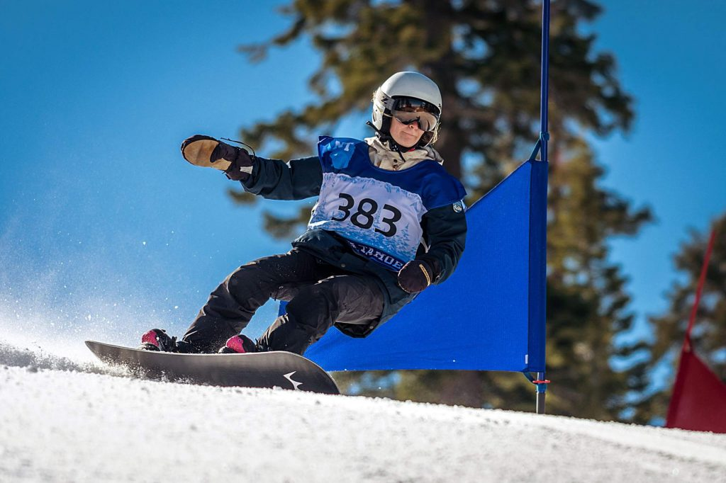 North Tahoe senior Nina Burt closed out her high school snowboard race career with a giant slalom title along with a runner-up finish in slalom to win the combined state championship. For more race photos, visit LefrakPhotography.com.