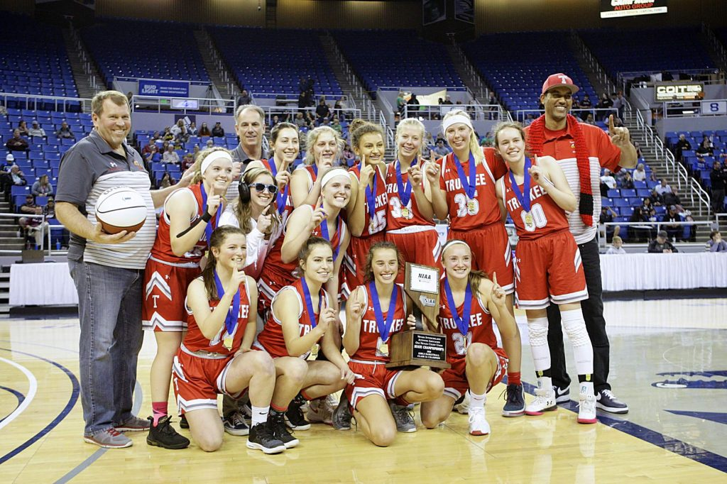 The Truckee girls' basketball team poses after claiming the program's first state championship.