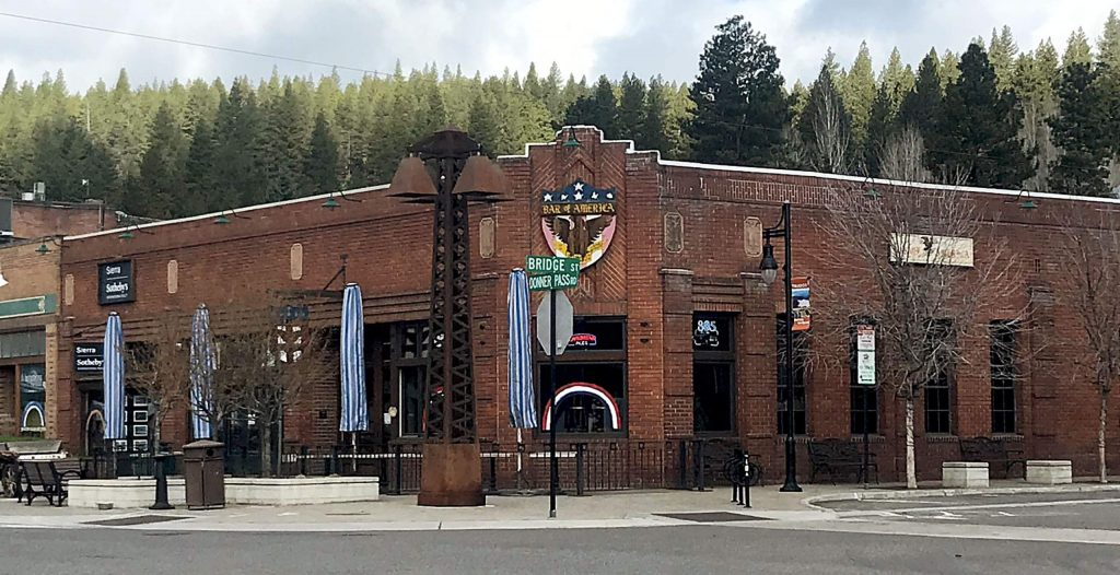 Atelier Truckee owner Heather River painted rainbows on windows of Truckee businesses.
