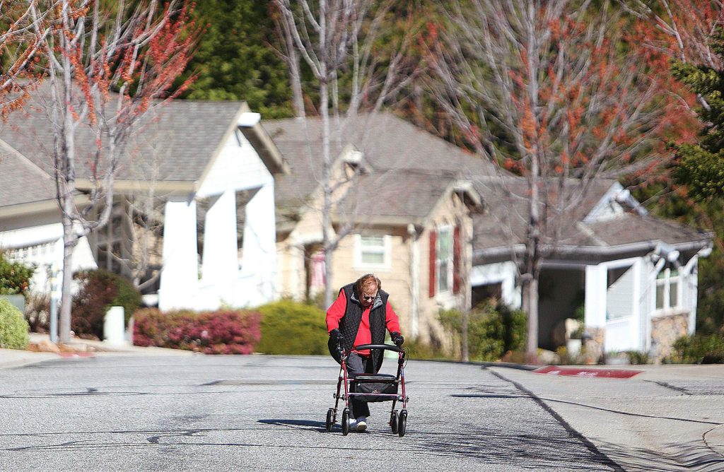 Adele Frickman, who just turned 98 years old, makes her way up Sparrow Circle at Grass Valley's Eskaton senior living community. Frickman, like others, takes part in a morning walk to help signify to their neighbors that they are OK during this pandemic.