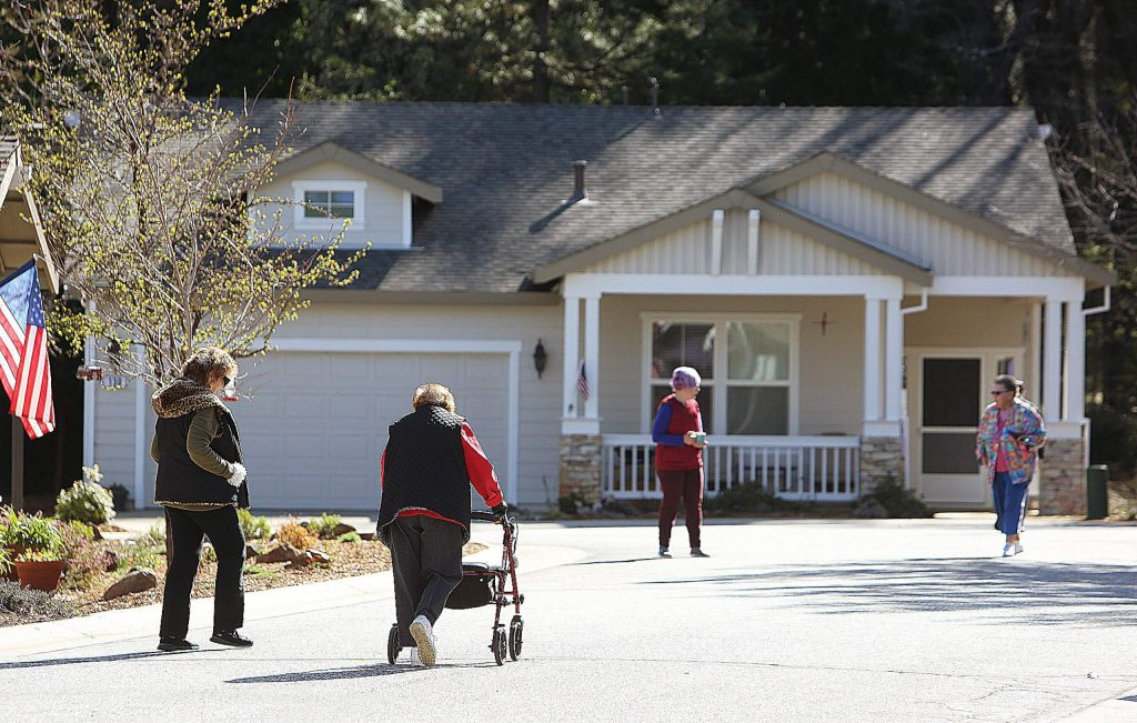 Sparrow Circle residents in Grass Valley have been good about keeping their distance from one another while taking part in the morning walk. Aside from their needed exercise, the walk is a way for the neighbors to let one another know they're OK.