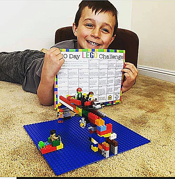 A student completes Day 1 of a Lego Challenge.