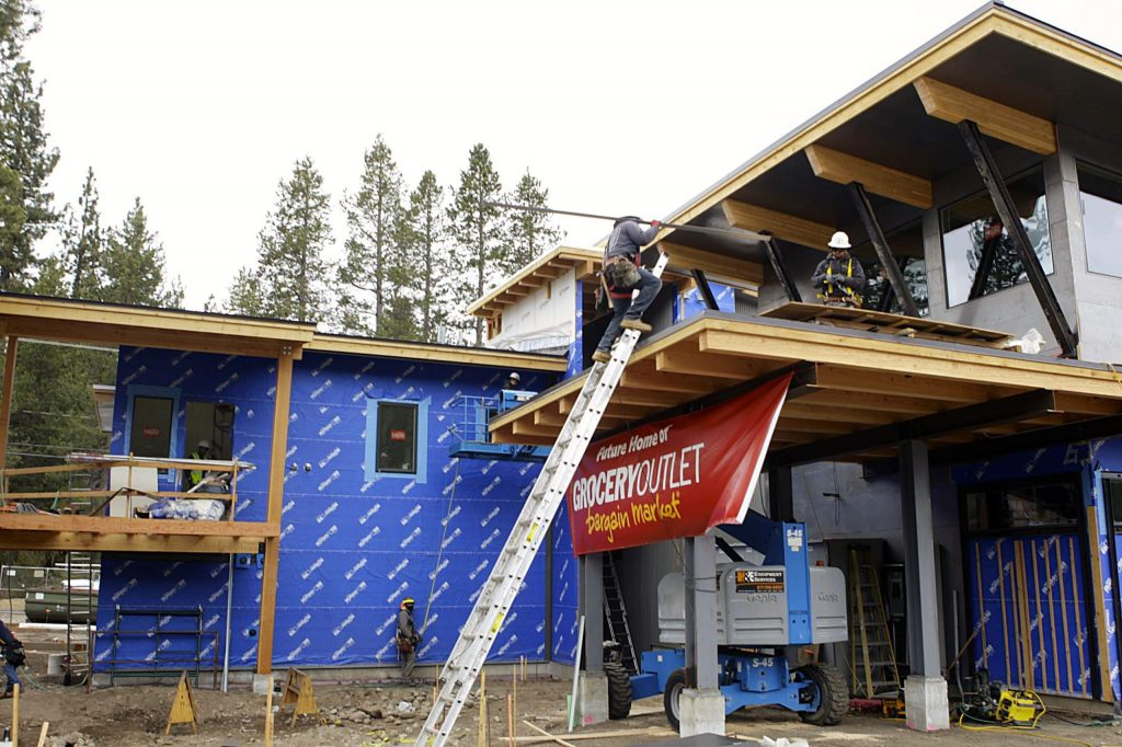 Workers labor to complete the Grocery Outlet on Donner Pass Road. The store is set to open Thursday at 7 a.m.