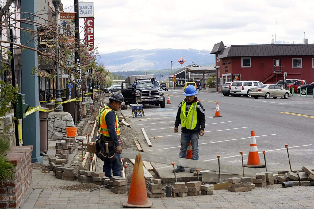 Workers replace a section of curb and gutter along Downtown Truckee.