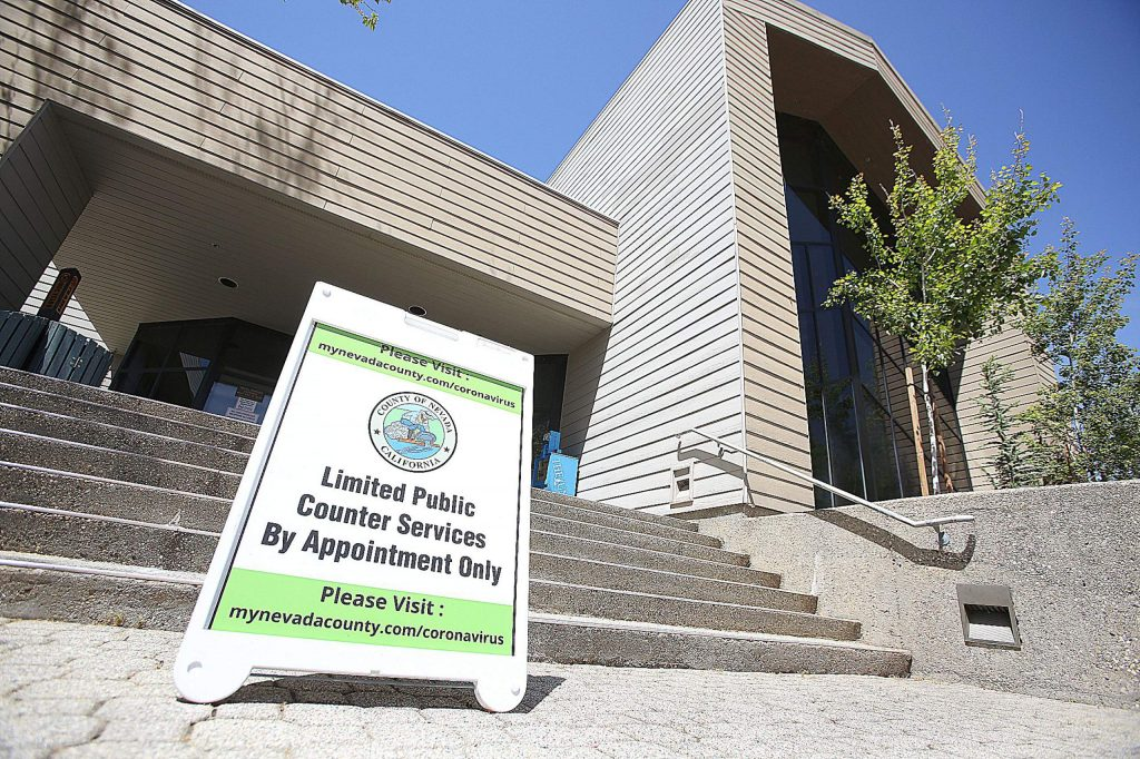 A sign about limited public services greets people at the entrance of the Eric Rood Administrative Center in Nevada City.