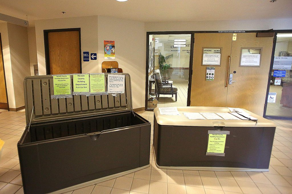 In an effort to continue to provide services through Nevada County's Building Department, drop bins for building permits and other Building Department business are placed in front of the doors to the Eric Rood Administrative Center, which is now closed to the public due to COVID-19.