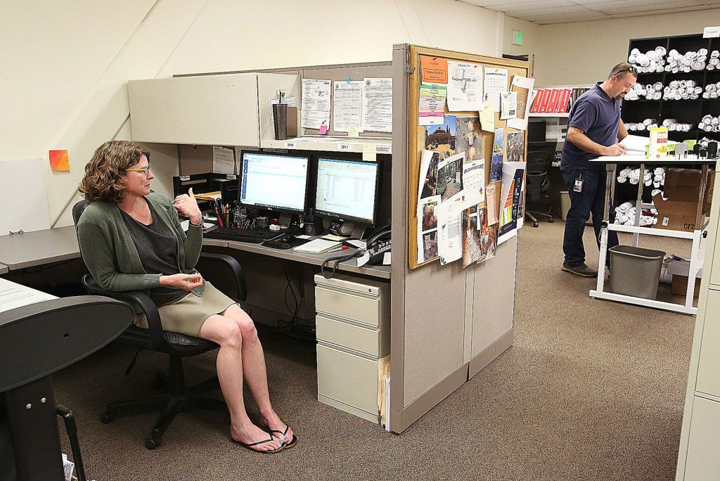 Nevada County's Julie Miller comes to the Eric Rood Administrative Center to answer phone calls to the county's Building Department. Building inspector Ben Miller, no relation, also conducts business from the office when necessary.