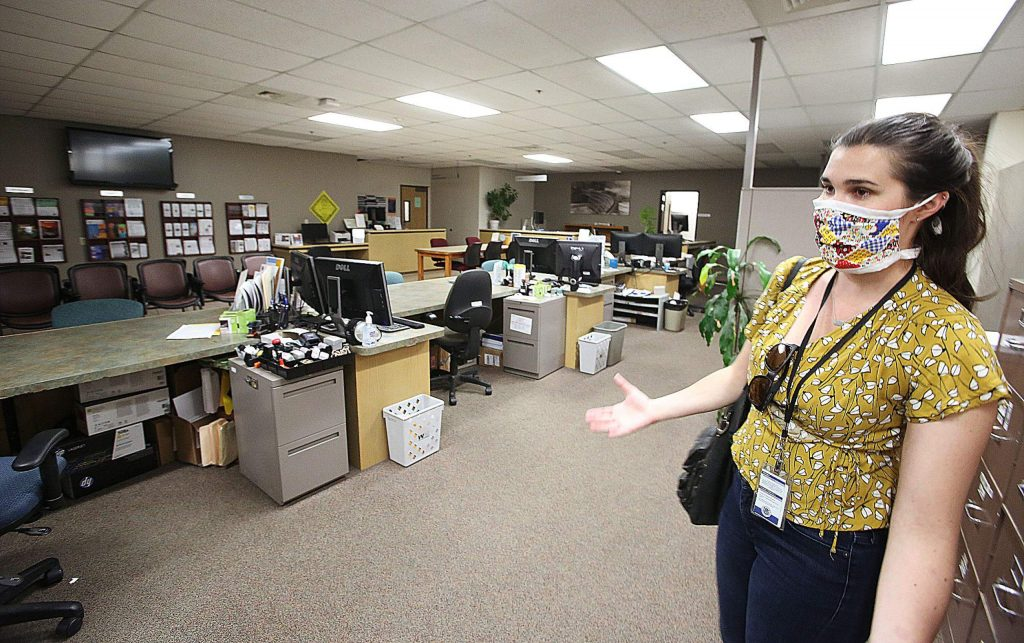 Nevada County Administrative Analyst and Public Information Officer Taylor Wolfe shows the empty building department as most employees are working from home now to help prevent the spread of COVID-19.