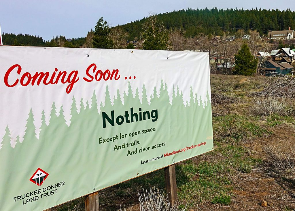 """Coming soon … nothing"" reads a recently installed sign by the Truckee Donner Land Trust at a downtown open space known as Truckee Springs."