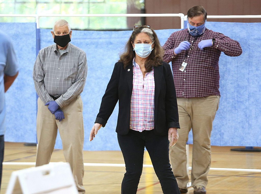 "Nevada County Board of Supervisors Chair Heidi Hall, center, underwent a COVID-19 test this week at the Grass Valley Veterans Memorial Building, a new testing site along with another opened in Kings Beach this week. ""Having the ability to test is essential to keep us safe,"" Hall said."