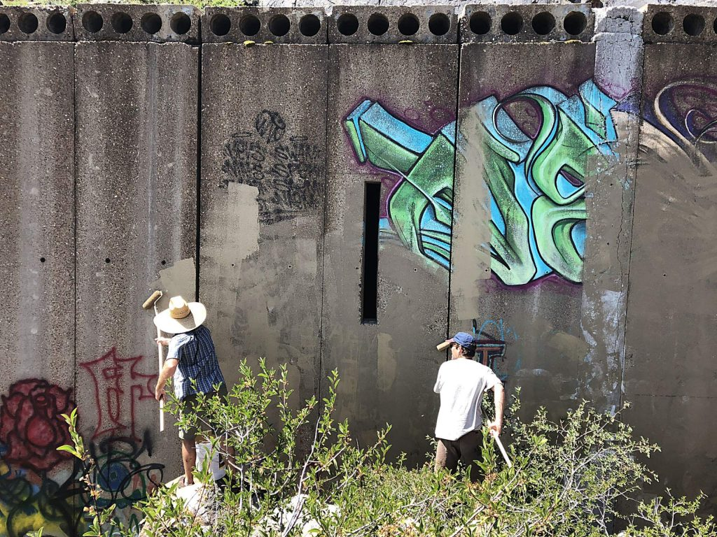 North Tahoe Climbers Coalition removes graffiti from wall.