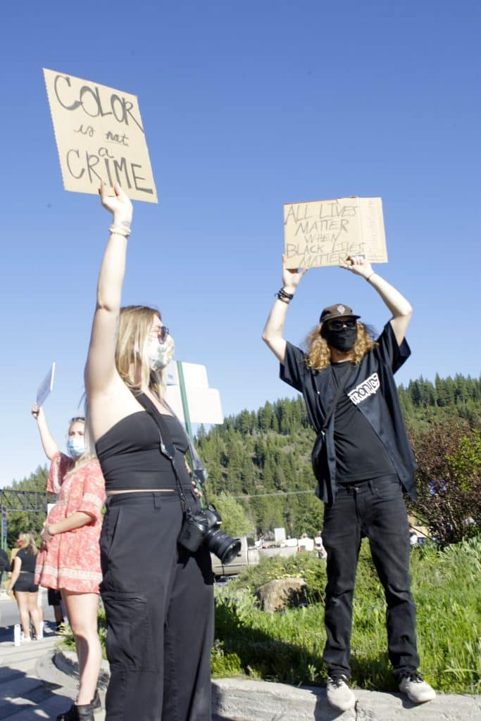 Hundreds gathered along Donner Pass Road in Truckee to peacefully reflect on those killed by law enforcement while denouncing systematic racism in the U.S.