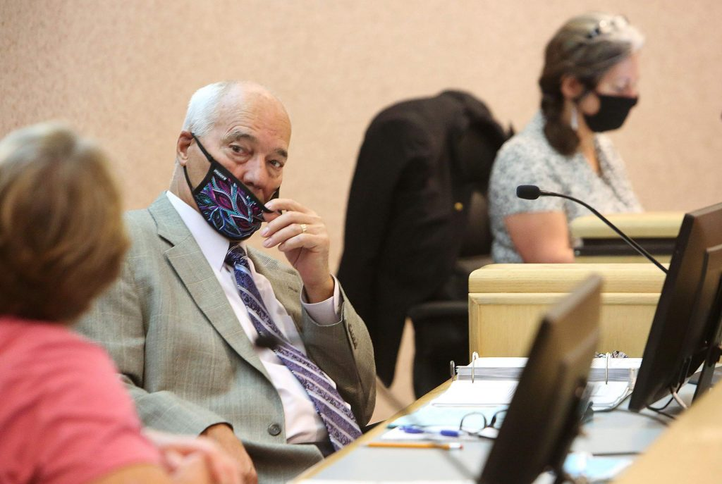 Nevada County Supervisor Dan Miller pulls his mask down below his nose during Tuesday morning's Board of Supervisors meeting, the first publicly held meeting since the coronavirus shutdowns in mid-March.