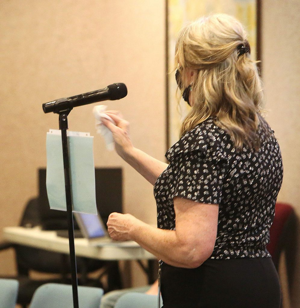 The public comment period microphone is disinfected following each speaker's comments during Tuesday's Nevada County Board of Supervisors meeting.