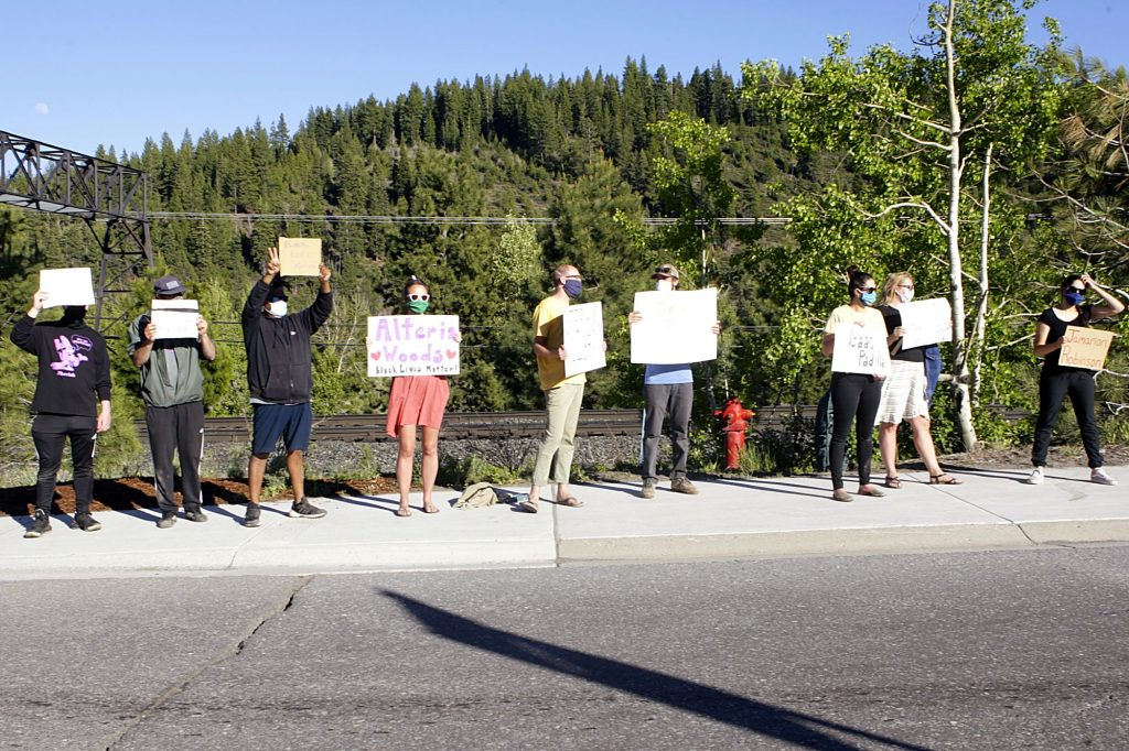 Truckee and Tahoe locals lined Donner Pass Road to denounce systematic racism in the U.S.
