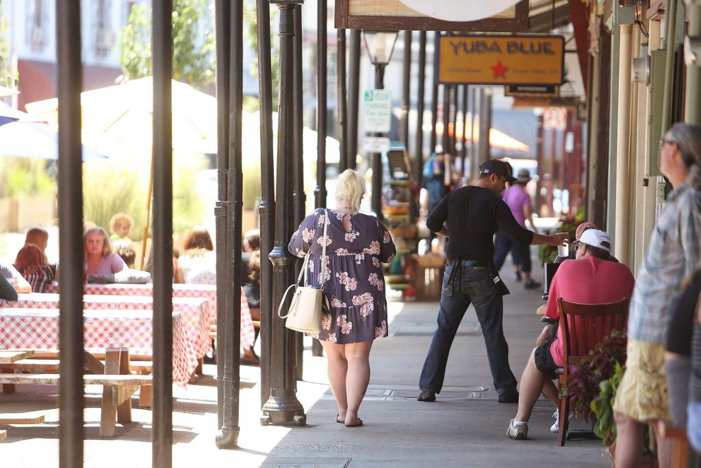 Outdoor dining customers are served in front of Old Town Cafe Wednesday, one of a handful of area businesses to reportedly receive a fine from Nevada County Environmental Health. Fines begin at $25 a day and go up to $1,000 a day for violations.