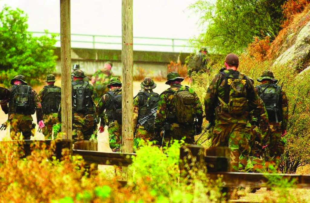 A mix of law enforcement agencies come down from the South Yuba Trail after a marijuana bust near the Highway 49 bridge Wednesday.
