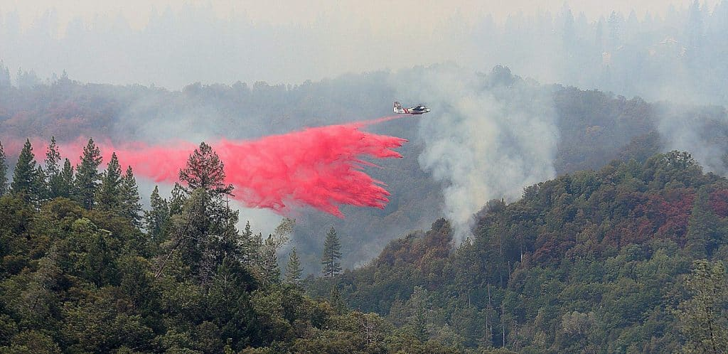 Cal Fire air tanker 94 makes a Phos-Chek drop over a portion of the Jones Fire Tuesday morning in the South Yuba River Canyon.