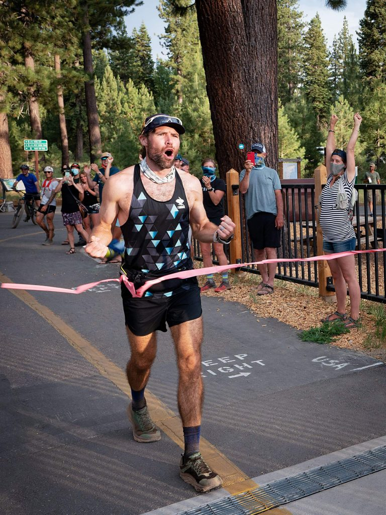 Tahoe City's Adam Kimble reaches the finish line after breaking the fastest known time on the Tahoe Rim Trail.