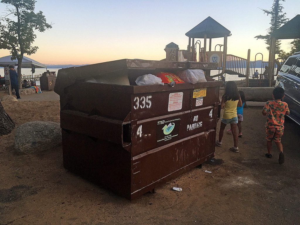 A trash bin is jammed full at Kings Beach State Park.