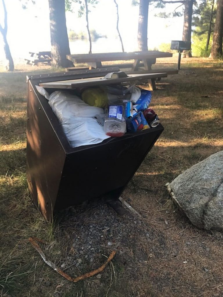 Land managers encourage people to bring their trash home if the dumpster is already full.