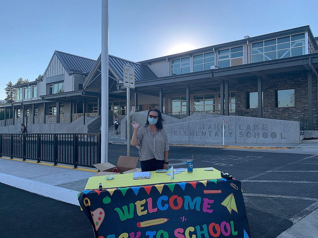 Superintendent Carmen Ghysels welcomes back students during a drive through textbook pick up at the newly upgraded Tahoe Lake Elementary School.