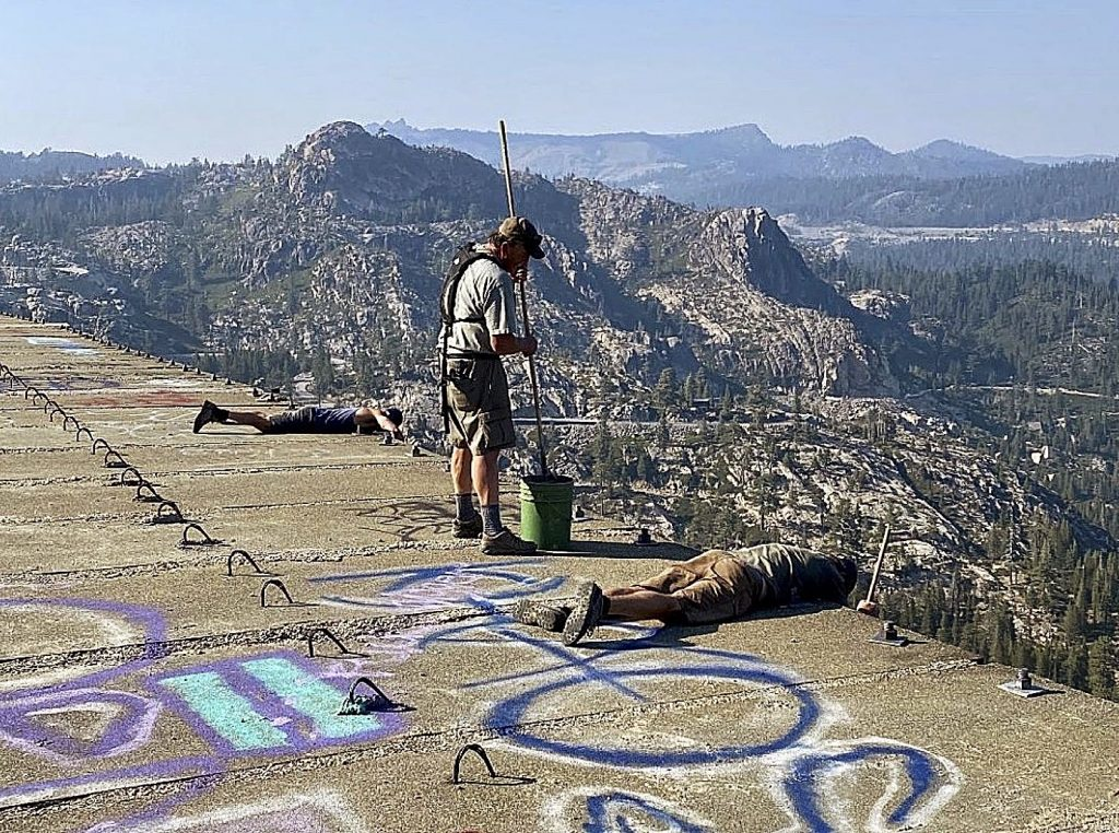 Top-side graffiti removal on the Donner Summit snowsheds.