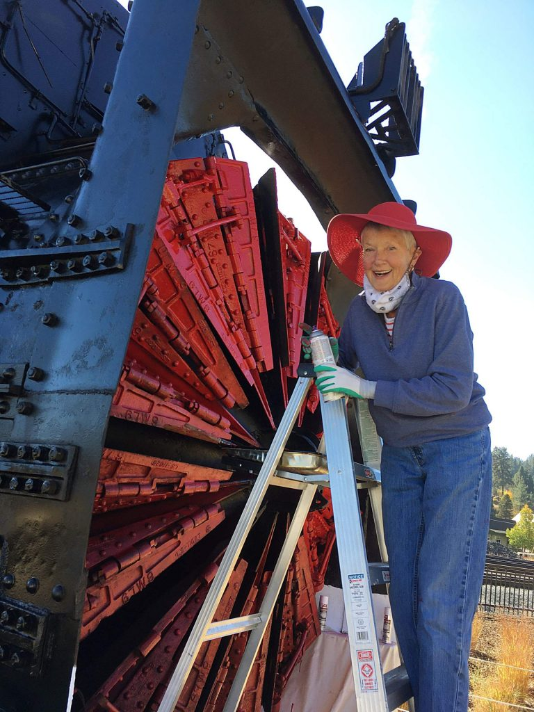 Carolyn Wallace Dee, former mayor of Truckee and a member of the Truckee Donner Railroad Society, is stylishly involved repainting the old rotary snowplow at Truckee's pocket park.
